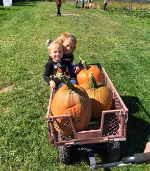 Sweet sister time in the pumpkin patch at Monroe's Orchard!
