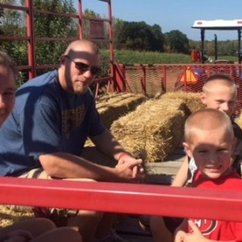 Family togetherness grows at Monroe's Orchard! Love that father & son time!